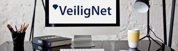 Banner van VeiligNet op computer
